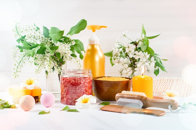 Spa and bath accessories with bath salts and beauty treatment products on white table. wellness concept