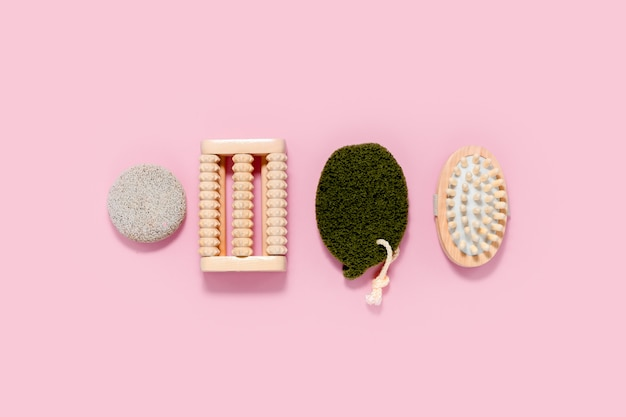 Spa and bath set on abstract pink background. skin and body care concept. top horizontal view copyspace