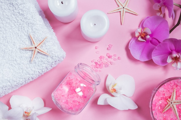 Spa beauty cosmetics on pink table from above . copy space flat lay