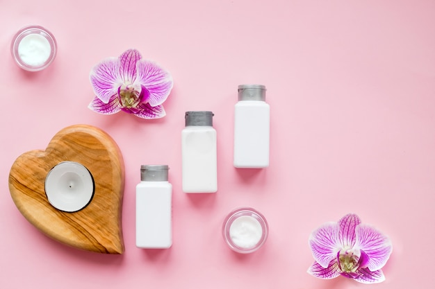 Spa beauty products . coconut oil, cream, serum, perfume, candles. beauty blog concept.spa procedure attributes, face and body cream,orchid flowers. retinol moisturizing anti aging