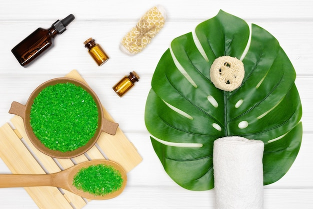 Spa and cellulite treatment products and accessories on white wooden table. top view, flat lay
