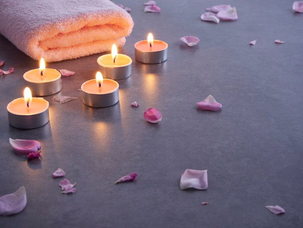 Spa composition of candles and rose Premium Photo