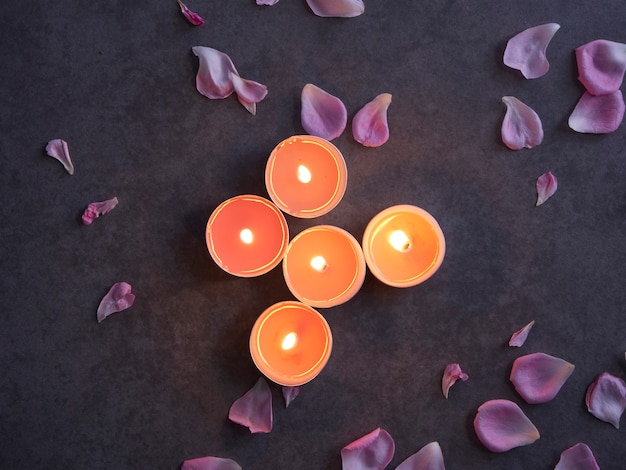 Spa composition of candles and rose. Premium Photo