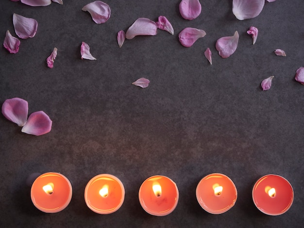 Spa composition of candles and rose.