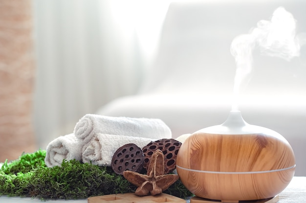 Spa composition with the aroma of a modern oil diffuser with body care products.