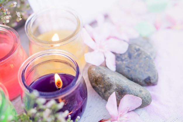 Spa composition with aromatic candle light and orchid flowe