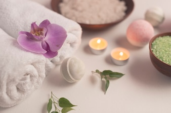 Spa composition with bath bombs and lit candles