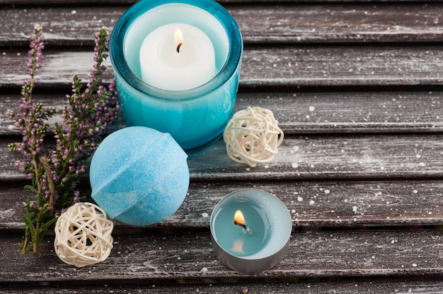 Spa composition with blue bath bomb and heather flowers