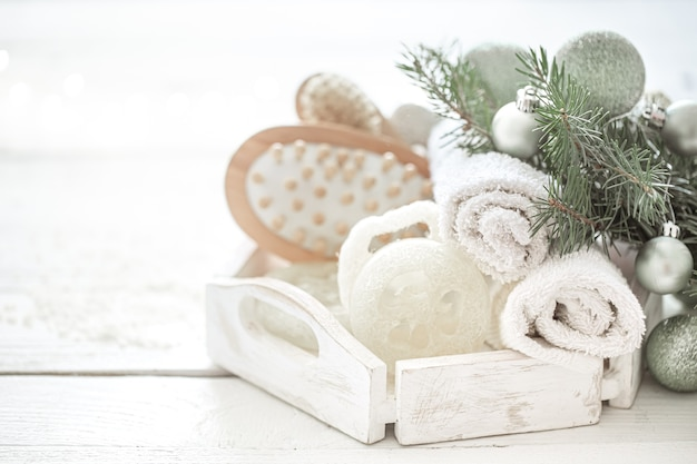 Spa composition with christmas decoration on blurred background. healthy lifestyle, body care, spa, and relaxation concept.
