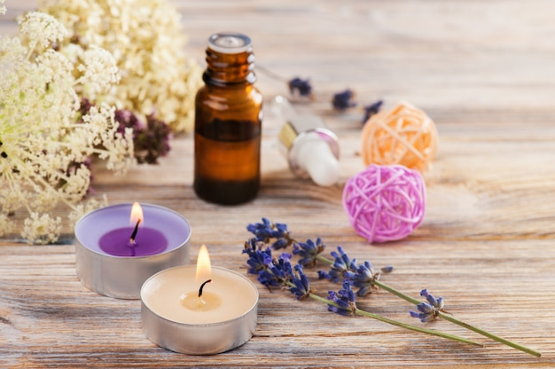 Spa composition with essential oil and candles