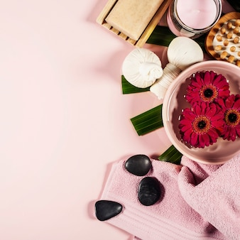 Spa composition with flowers and towel. flat lay