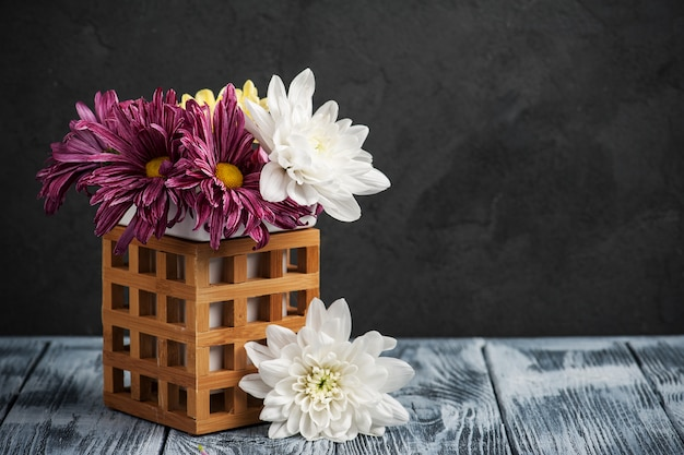 Spa composition with lit chrysanthemum