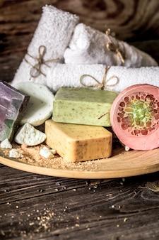 Спа композиция с мылом на деревянном фоне,
