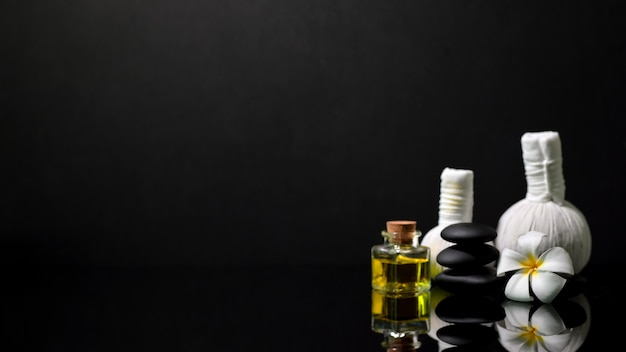Spa composition with spa accessories on dark background