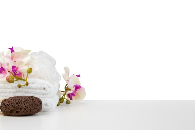 Spa composition with towels and flowers isolated on white