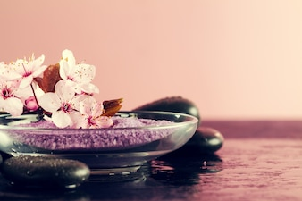 Spa Concept. Closeup of beautiful Spa Products - Spa Salt and Flowers. Horizontal.