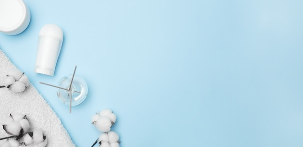 Spa concept, cotton white jars on a blue background, copy space, top view. high quality photo