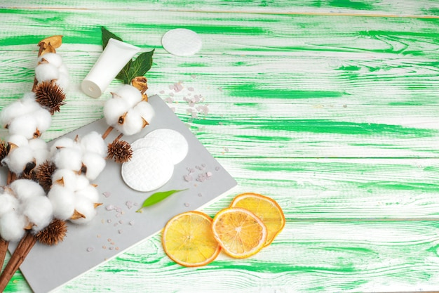 Spa concept. flat lay background with cotton branch, cotton pads. cotton cosmetic makeup