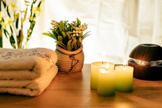 Spa concept. towels, candles and humidifiers for relaxation and massage treatments.