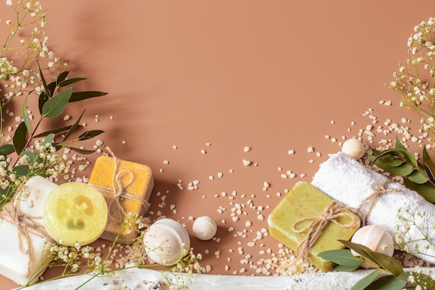 Spa concept with body and face accessories on colored background. place for text