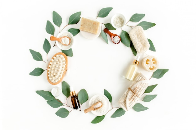 Spa concept with eucalyptus oil and eucalyptus leaf extract natural spa cosmetics products. flat lay