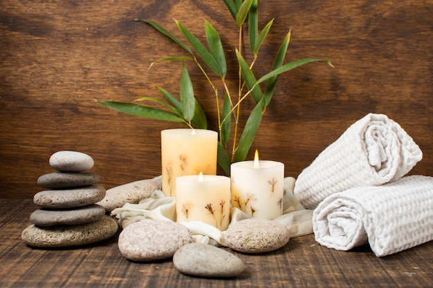 Spa concept with lit candles and towels