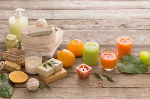 Spa concept with orange fruits on old wooden table
