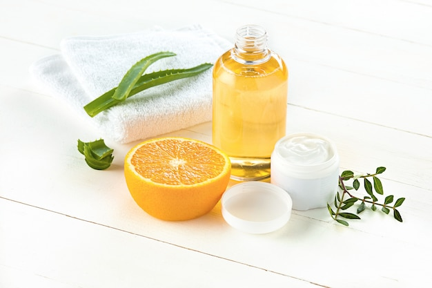 Spa concept with salt, mint, lotion, towel on white background