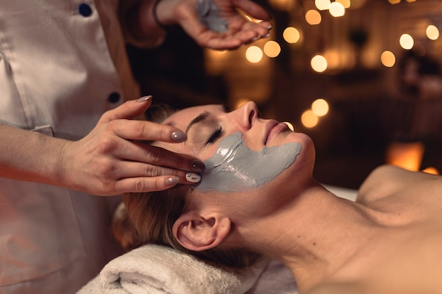 Spa concept with woman with creme in face