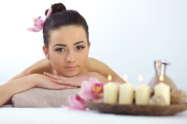 Spa concept. young pretty woman relaxing in the salon, close up