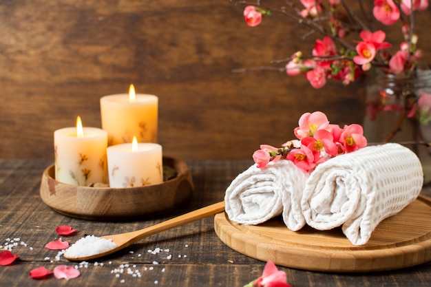 Spa decoration with lit candles and towels