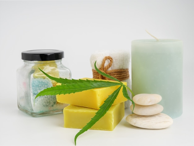Spa hemp extract products with cannabis leaf soap bar and  white towel stone on white background
