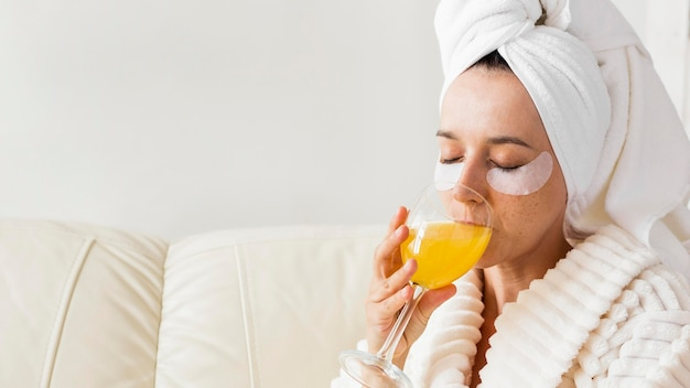 Spa at home woman drinking healthy juice close-up