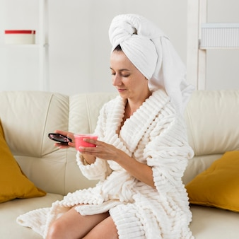 Spa at home woman holding a pink cream