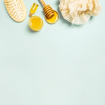 Spa ingredient and spa equipment on plain background