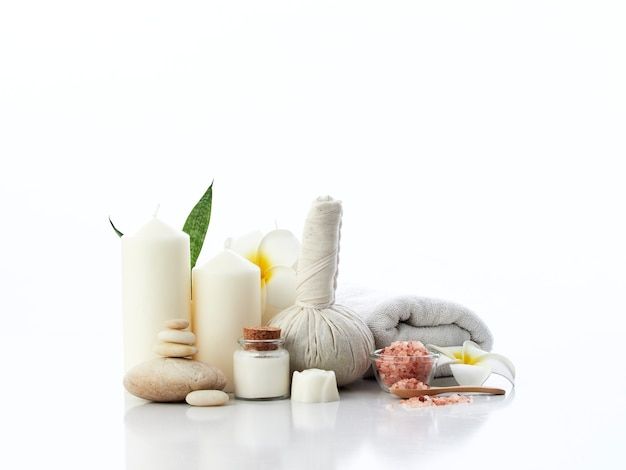 Spa massage concept, herbal compress ball, cream, flower soap, scented candle and himalayan pink salt, isolated