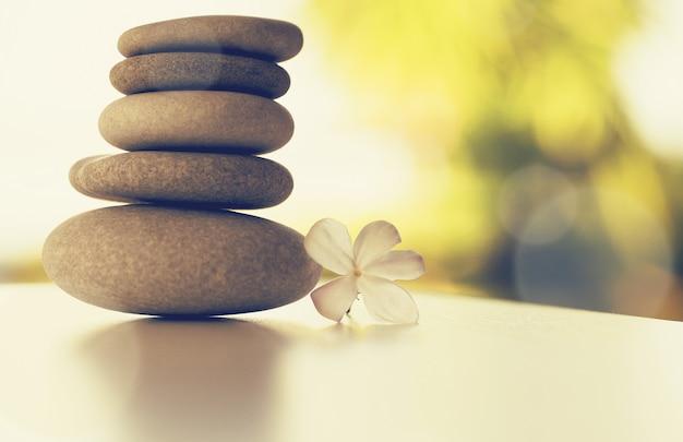 Spa massage stones and white gardenia flower