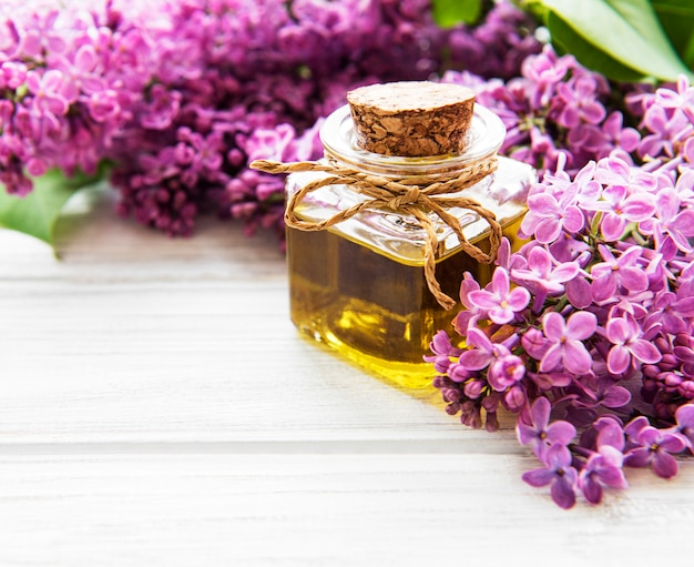 Spa oil with lilac flowers
