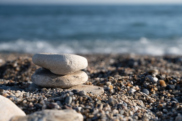 Spa pebbles on the background of the sea.