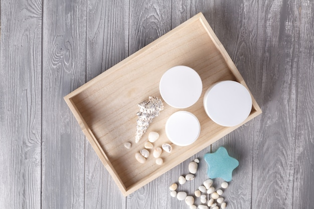 Spa procedure concept, different cosmetic jar and bottle on wooden table