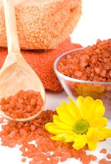 Spa pruducts: bath salt, oil balls, towels and flower