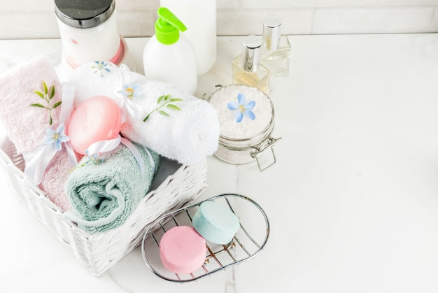 Spa relax and bath concept, sea salt, soap, with cosmetics and towels in bathroom