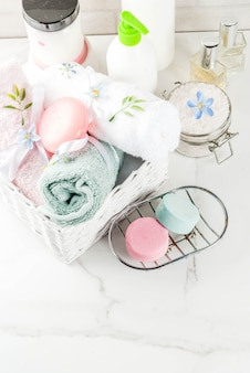 Spa relax and bath concept, sea salt, soap, with cosmetics and towels