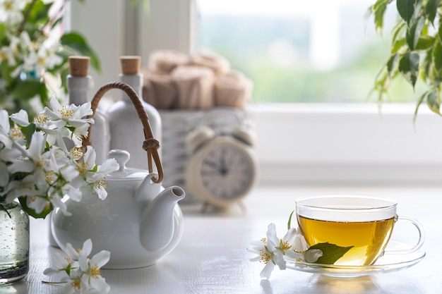 Spa resort at home with tea made of jasmine flowers on a white background. copy space. spa and wellness concept.