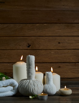 Spa set with alight candles.