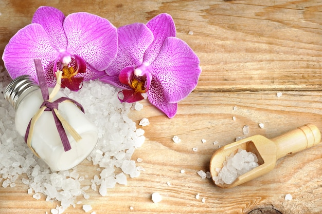 Spa set with body lotion, bath salt, pink orchid flowers