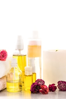 Spa setting with pink roses, sea salt and aroma oil, vintage style
