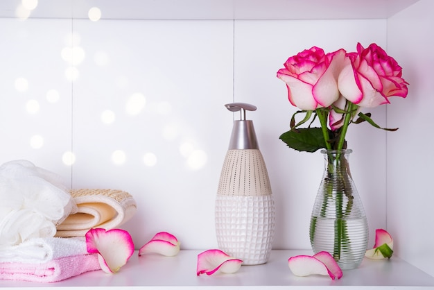Spa settings with roses and various items used in spa treatments for romantic valentines day
