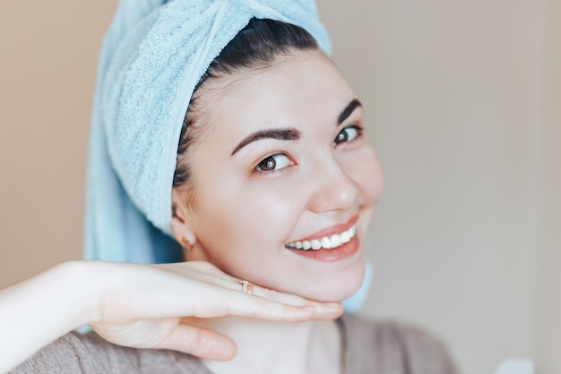 Spa skin care beauty woman wearing hair towel after beauty treatment.