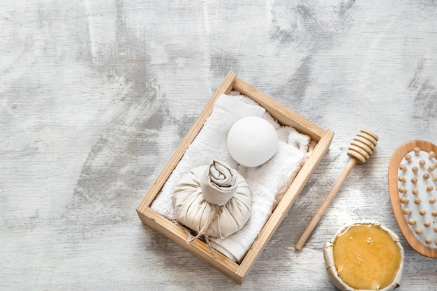 Spa skin care items in wooden box .